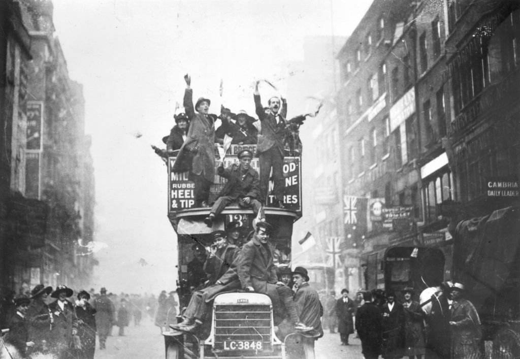 Crowds  celebrating  the  signing  of  the  Armistice  at  the  end  of  World  War  I,  11  November  1918.  Photo  by  Topical  Press  Agency_GettyImages