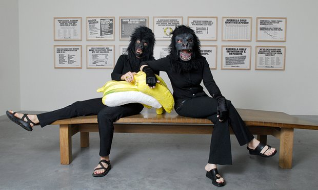 Two of the Guerrilla Girls pose at a Tate Modern exhibition in 2006. Members of the group wear gorilla masks in public to hide their identities. Photograph: Christian Sinibaldi