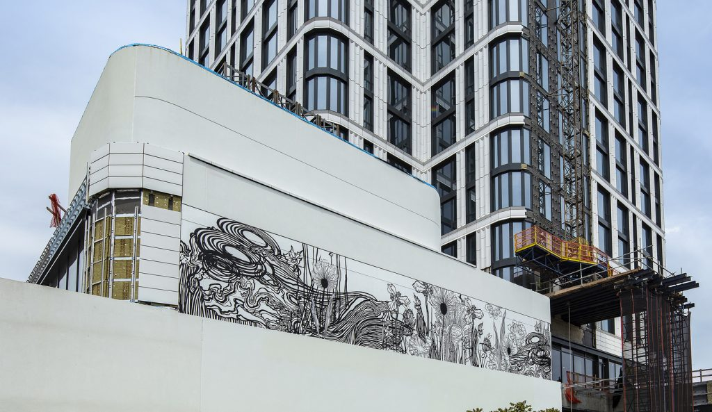Artist Swoon creates gigantic mural on 23-story, terra-cotta and glass tower The Dime