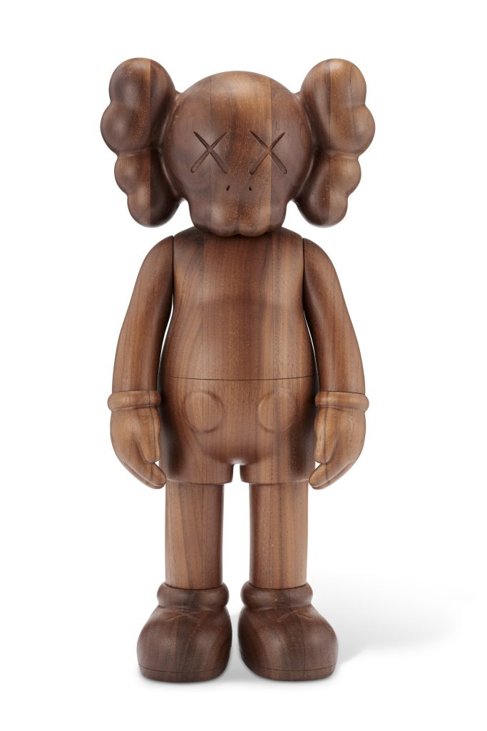 KAWS (B.1974) COMPANION (KARIMOKU VERSION) signed and numbered 'KAWS..42/100' and stamped '???? [KARIMOKU] OriginalFake' (on the underside) wood multiple, with the original packaging, box and hologram Overall: 101?2 x 5 x 21?2 in. (26.7 x 12.7 x 6.4 cm.) Executed in 2011. This work is number 42 from the edition of 100. Co-published by OriginalFake and Karimoku, Tokyo. FADmagazine