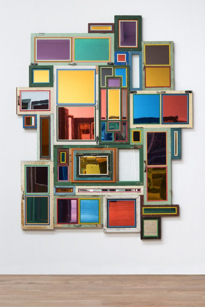 "Song Dong, Usefulness of Uselessness - Varied Window No. 12, 2018-2019, old wooden windows, mirror, mirror panel, glass, 188 cm × 240 cm × 8 cm (74"" × 94-1/2"" × 3-1/8"") © Song Dong 66221.02.jpeg Song Dong, Eating the City - Vienna 02, 2007, color photograph, 90 cm x 60 cm (35-7/16"" x 23-5/8""), Edition of 5 + 2 APs © Song Dong"