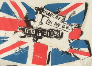 Jamie Reid, Anarchy In The UK, 1976. Screen print on muslin, 690mm x 900mm approx. Private Collection.