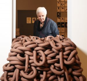 Artist Anna Maria Maiolino with her unfired clay sculptures at the private view for the UK's first retrospective of her life's work, titled Anna Maria Maiolino: Making Love Revolutionary at Whitechapel Gallery, London. PRESS ASSOCIATION Photo. Picture date: Tuesday September 24, 2019. The exhibition, which spans six decades of work will run from September 25th to January 12th, 2020 and will bring together 150 works by the artist. Photo credit should read: Matt Alexander/PA Wire