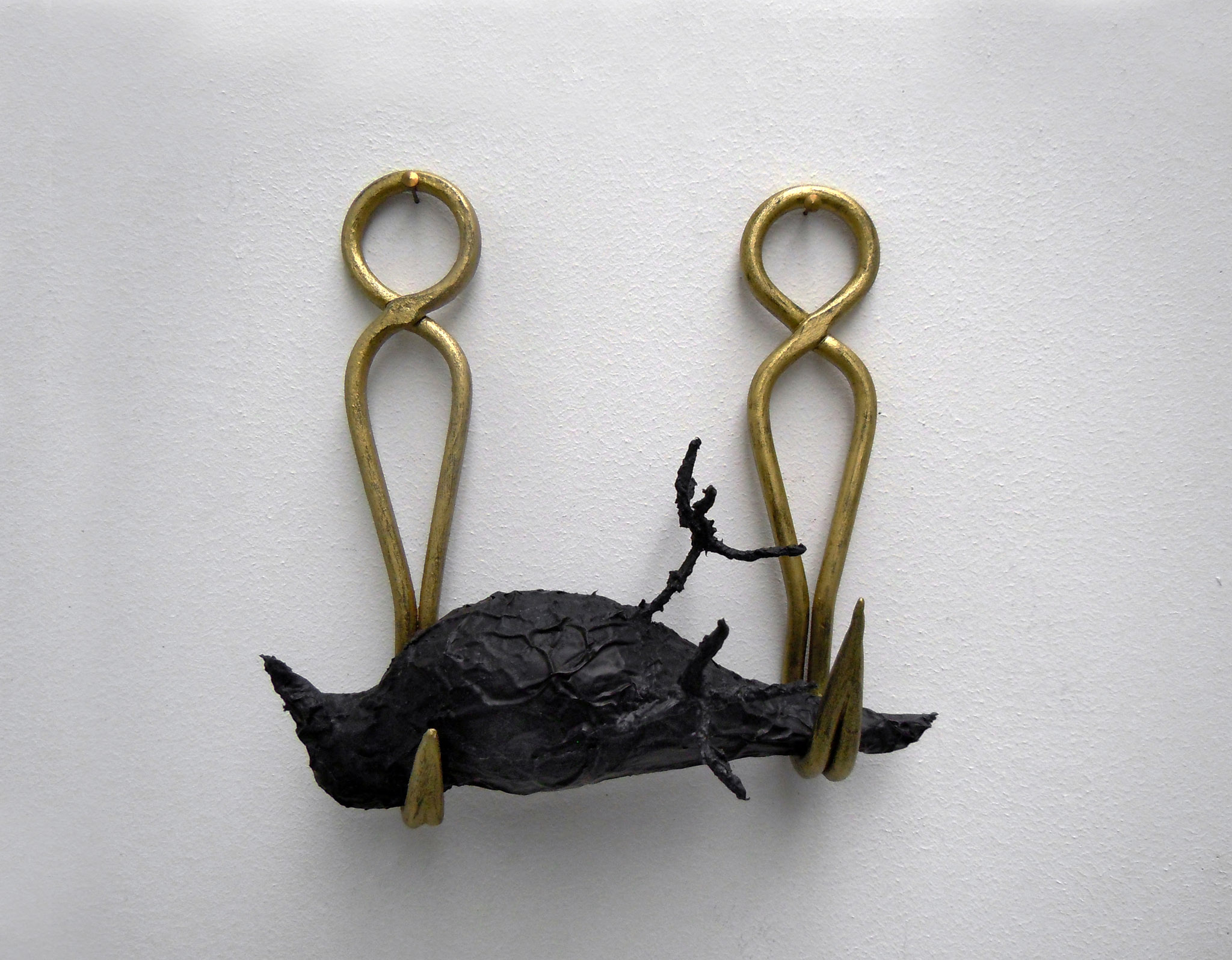 Annette Messager L'oiseau, 2015 Black aluminium foil, 2 painted hooks
