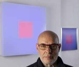 Brian Eno, musician and artist in his studio with lightbox and lenticular. April 2016