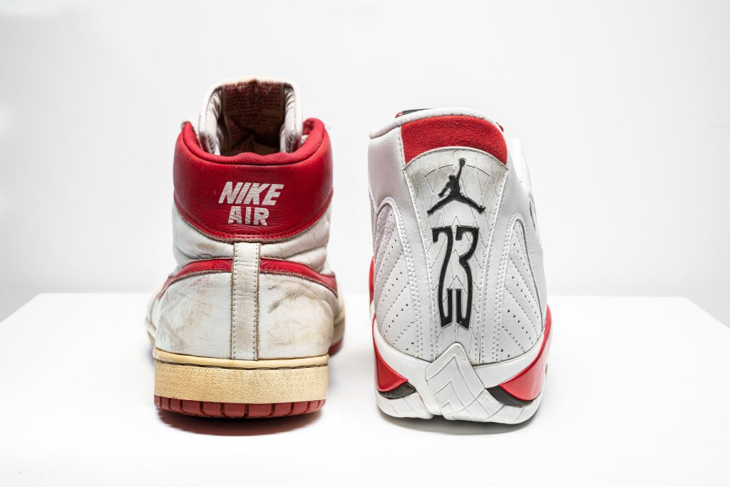 """IR SHIP, MJ PLAYER EXCLUSIVE, GAME-WORN SNEAKERS, NIKE, 1984 LEFT SHOE: SIZE 13.5, RIGHT SHOE: SIZE 13, HIGH-TOP ESTIMATE $350,000 – 550,000 AIR JORDAN 14 """"CHICAGO"""", PLAYER EXCLUSIVE, PRACTICE-WORN SNEAKERS, NIKE, 1998 SIZE 13, MID-TOP ESTIMATE $6,000 – 8,000"""