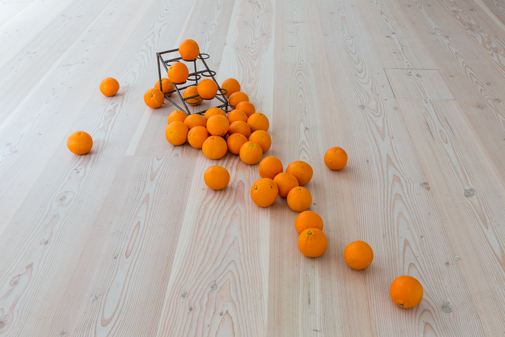 Delfina Foundation Senam Okudzeto (Ghana/UK/USA), PORTE-ORANGES (CM), 2012 / PORTE-ORANGES (detail), 2004-2007 Metal sculptures, oranges, video, sound. Duration: 6.32 min Photo © Tim Bowditch