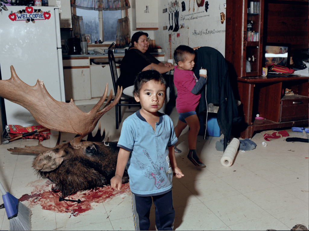 Family in Shamattawa Aboriginal Reserve, Manitoba, Canada, 2, 2012 courtesy Mark Neville