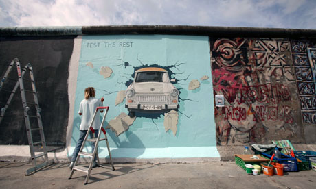 Image:Artist Birgit Kinder Paints Her Picture Trabi At The East Side  Gallery On The Site Of The Berlin Wall In Germany. Photograph: Maya Hitij/AP