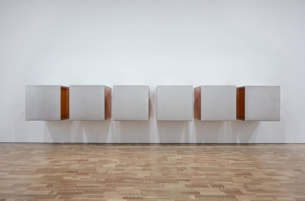 """Donald Judd. Untitled. 1973. Plywood; five units, each 72 × 143 × 72? (182.9 × 363.2 × 182.9 cm), with 12? (30.5 cm) intervals. Overall: 72 × 479 × 72"""" (182.9 × 1216.7 × 182.9 cm). An additional sixth unit fabricated in 1975. National Gallery of Canada, Ottawa © 2020 Judd Foundation / Artists Rights Society (ARS), New York FAD MAGAZINE"""