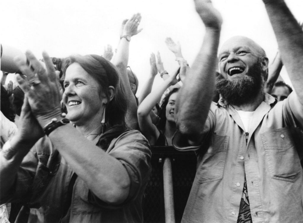 Jean and Michael Eavis cheer from the Pyramid Stage, 1992. © Brian Walker
