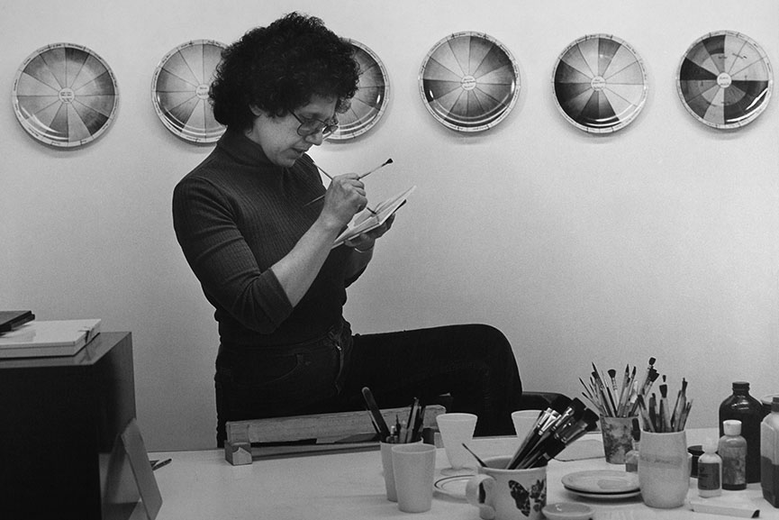 Judy-Chicago-at-work-in-her-china-painting-studio-in-1974.-Courtesy-of-Through-the-Flower-Archives
