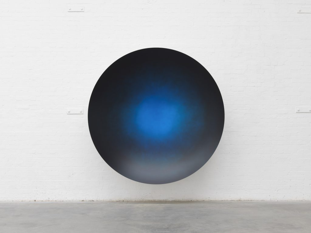 Anish Kapoor?Oriental Blue and Black Mist satin, 2019?Aluminium and paint?220 x 220 x 47 cm?86 1/2 x 86 1/2 x 18 1/2 in © Anish Kapoor. Courtesy Lisson Gallery. Photography Dave Morgan.