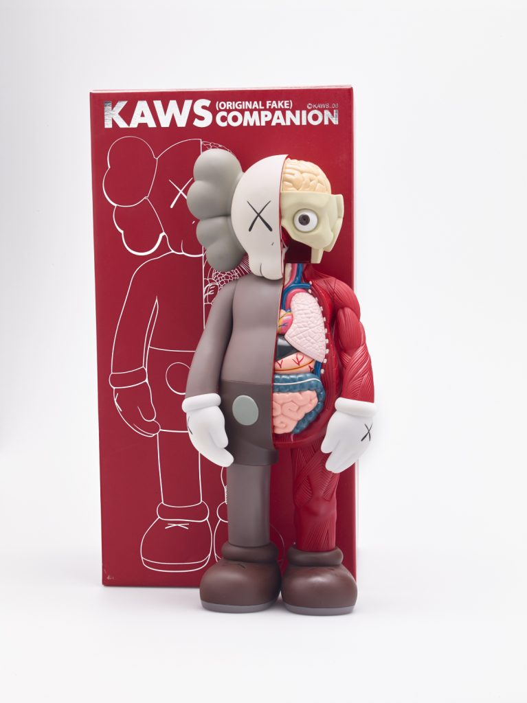 KAWS b. 1974  DISSECTED COMPANION (BROWN)  painted vinyl, with original Medicom packaging  37.5 x 16.5 x 8.9 cm (14 3/4 x 6 1/2 x 3 1/2 in.)  Executed in 2006, this work is from an edition of 500, fabricated by Medicom Toy and OriginalFake, Japan.