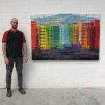 Kieran Flynn with his painting Jungle No2