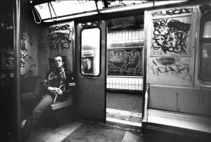 Tseng Kwong Chi Keith Haring in subway car, (New York), circa 1983. Photo © Muna Tseng Dance Projects, Inc. Art © Keith Haring Foundation