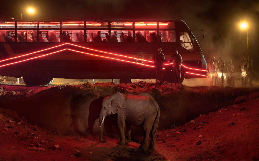 Nick Brandt, 'Bus Station with Elephant & Red Bus' (2018) © Nick Brandt & Atlas Gallery