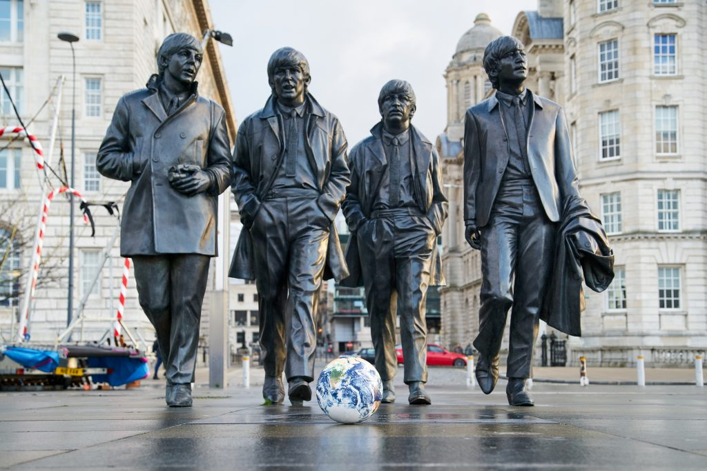 One World football at the Beatles statue in Liverpool. Photo by Rob Battersby