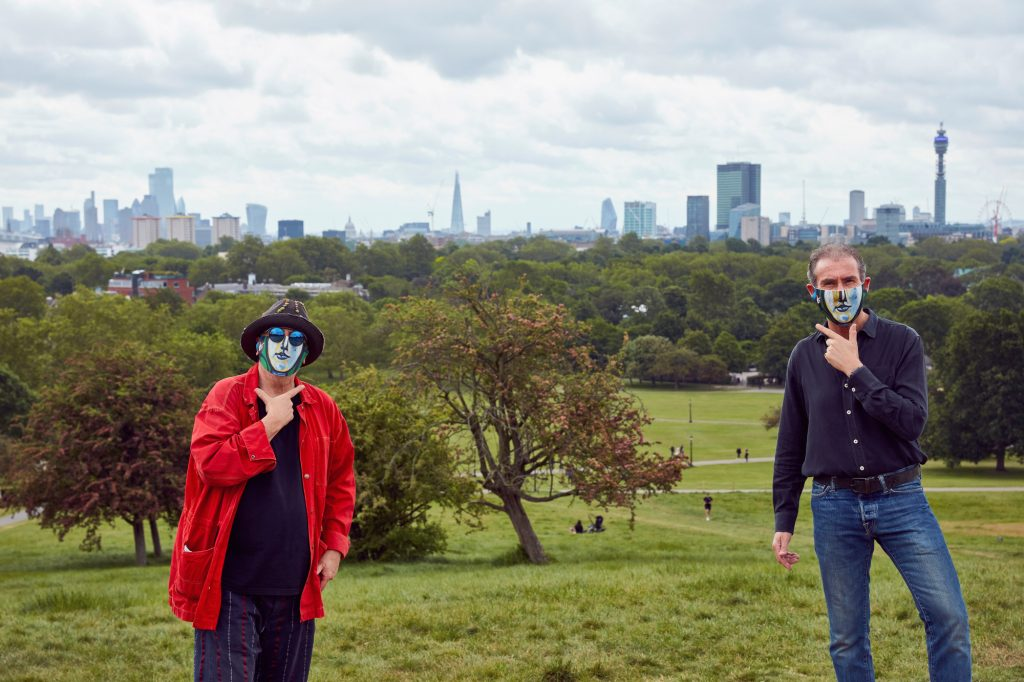 Ron Arad and Maurice Ostro was taken on Primrose Hill – and they are making the sign for 'Smile' in British Sign Language