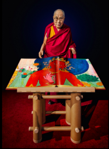Tenzin Gyatso, the Fourteenth Dalai Lama, with a draft copy of Murals of Tibet, Boston, 2014. FAD MAGAZINE