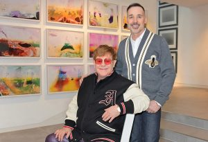 Sir Elton John and David Furnish at home in their art gallery © Dave Benett Getty Images for the V&A