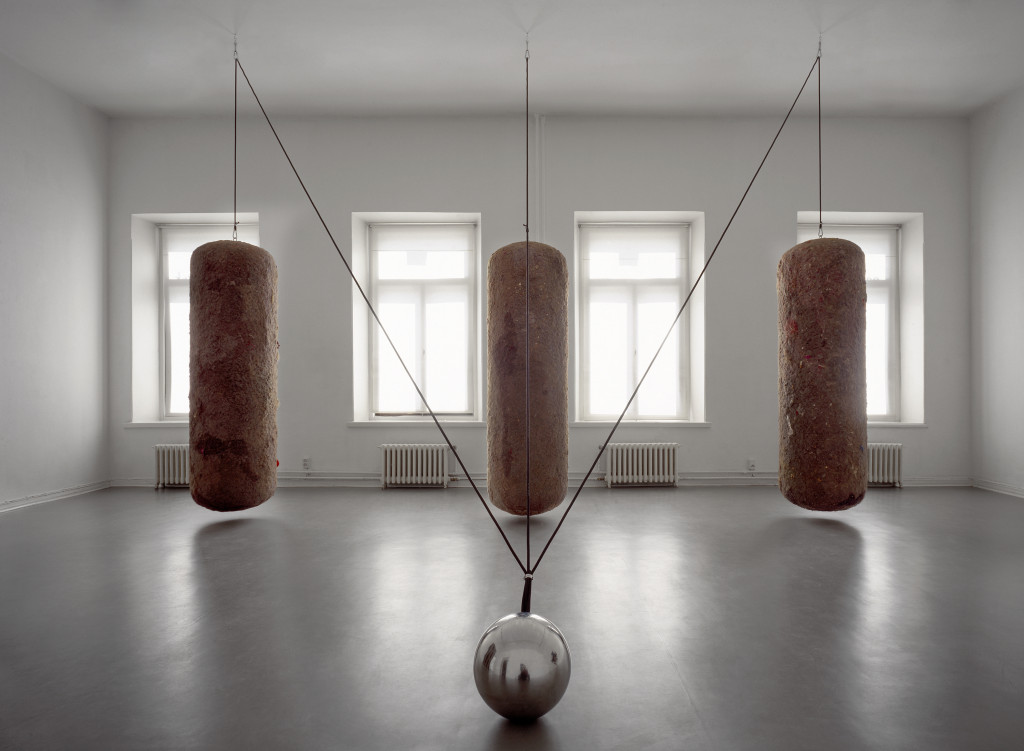 Timo Heino,Gravitation, 1999. House dust, rubber, stainless steel, lead shots, steel ball Ø 30 cm, three dust bales, 210 cm x 60 cm each