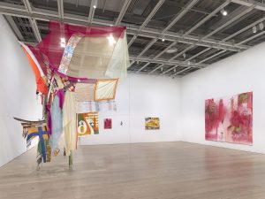 Installation view of the Whitney Biennial 2019 (Whitney Museum of American Art, New York, May 17-September 22, 2019). From left to right: Eric N. Mack, Proposition: for wet Gee's Bend Quilts to replace the American flag – Permanently., 2019; Jennifer Packer, Untitled, 2019; Jennifer Packer, An Exercise in Tenderness, 2017; Jennifer Packer, Untitled, 2019; Jennifer Packer, A Lesson in Longing, 2019. Photograph by Ron Amstutz