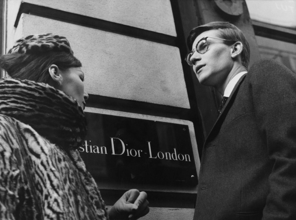 French fashion designer Yves Saint Laurent (1936 - 2008) in London, 11th November 1958. He is preparing for the following day's Dior Autumn collection show to an audience including Princess Margaret, at Blenheim Palace. (Photo by Popperfoto/Getty Images