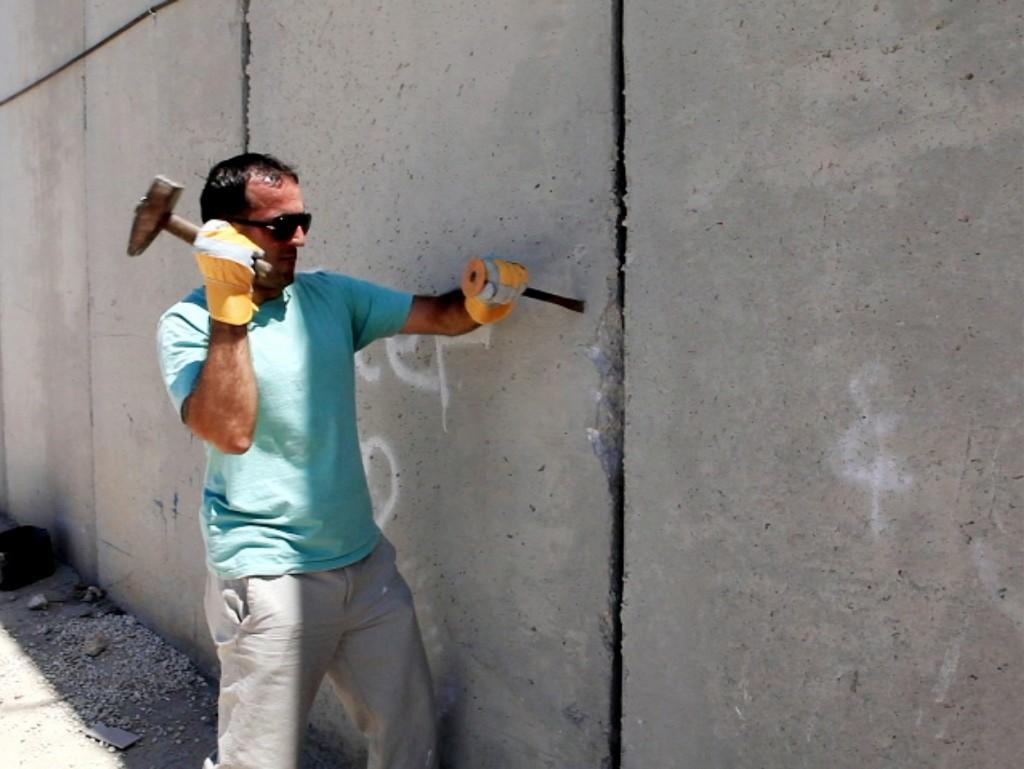 hjub KhaledJarrarStillfromvideoConcrete2012CourtesytheartistandAyyamGallery 1 1024x769 Artist Khaled Jarrar brings West Bank Wall to London this week !