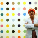 Damien Hirst in front of his dot paintings