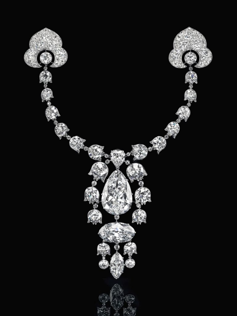 Devant-de-Corsage brooch, 1912, Cartier. Pear brilliant-cut diamond of 34.08 carats, oval brilliant-cut diamond of 23.55 carats, modified marquise brilliant-cut diamond of 6.51 carats, heart modified brilliant-cut diamond of 3.54 carats, lily-of-the-valley old-cut diamond links, platinum and 18k white gold (French marks), 7½ in, 1912. Signed Cartier