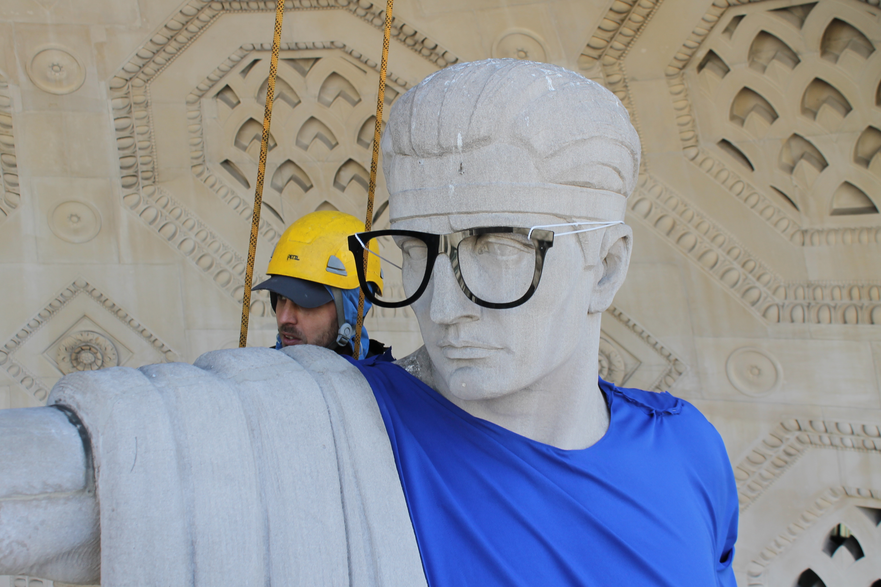 French artist Léo Caillard dresses classical statues as hipsters above entrance to Bush House London FAD MAGAZINE