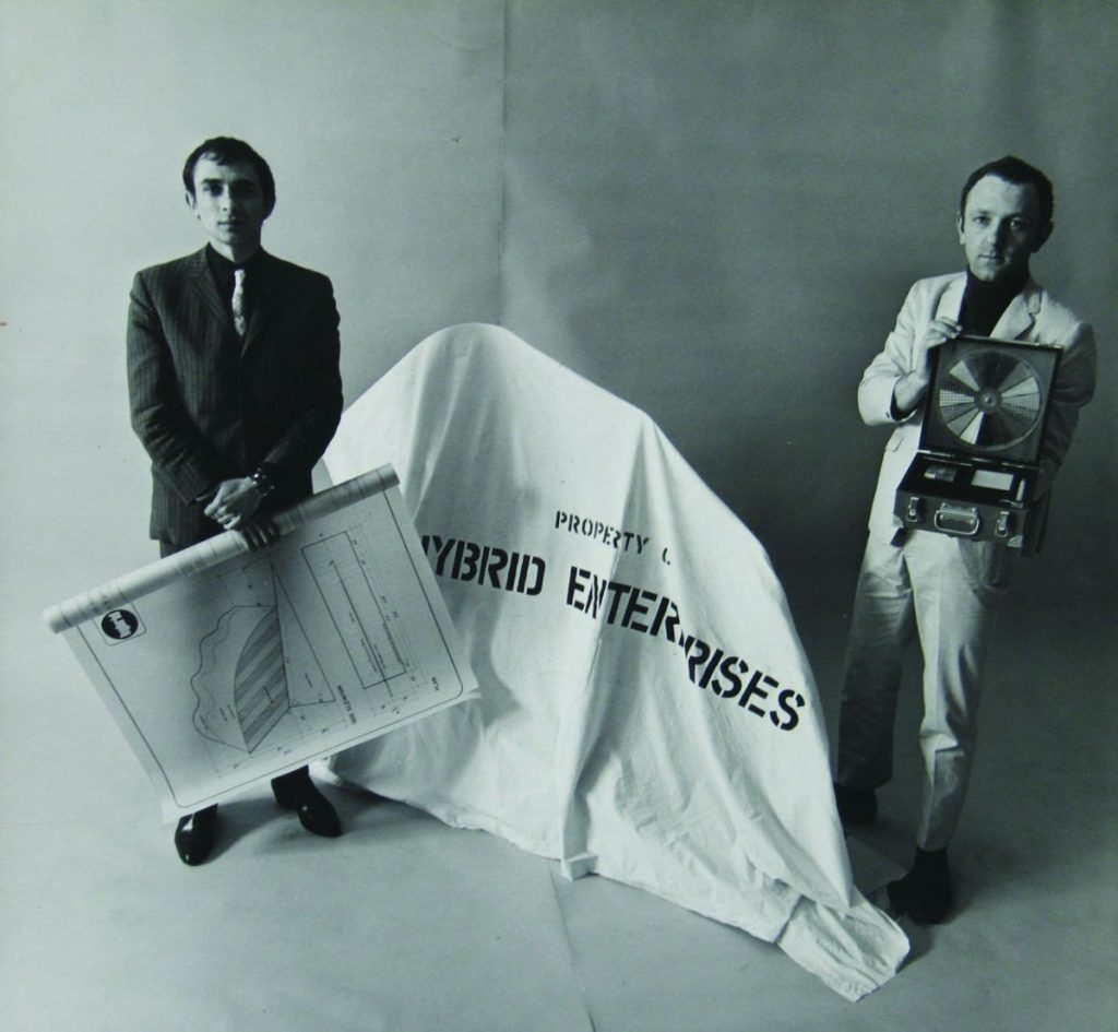 Peter Phillips and Gerald Laing with a covered Hybrid sculpture, blueprint, and research kit, New York, 1966;