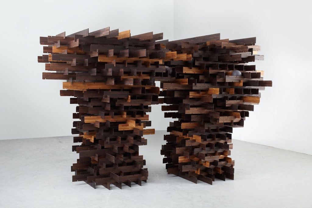 ALISON WILDING In a Dark Wood, 2012 Reclaimed laminated iroko and acrylic 210 x 370 x 217 cm