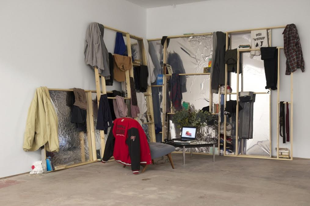David Raymond Conroy, 2010 – 2014, 2015 Artist's clothes, artist's books, wood, privacy film, Parker Knoll chair, Le Corbusier LC4 table, vase, dried flowers Production and Marketing, 2014/15 Single channel HD video 7 mins FAD Magazine