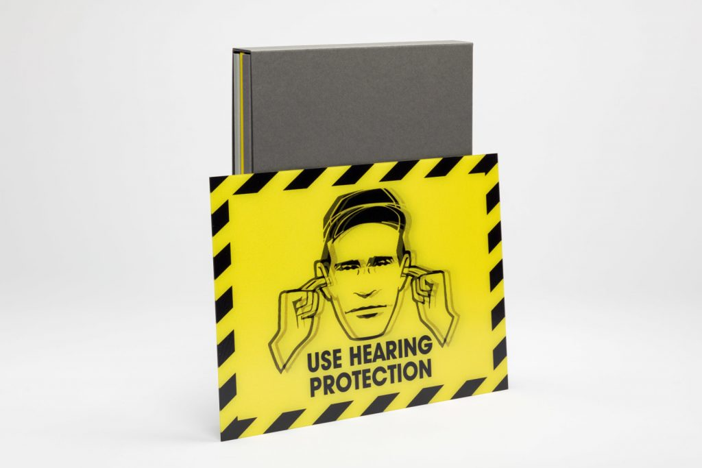 1 – 350 are accompanied by a limited edition lenticular print 'Use Hearing Protection', 2019. 26.8 x 18.4 cm. Presented in an envelope, signed and numbered by Peter Saville.