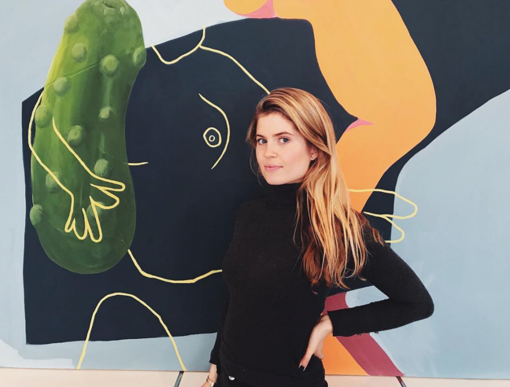 Founder & CEO Katharina Wenzel-Vollenbroich in front of a work by Billy Parker available on ARTPIQ, student at Slade School, London