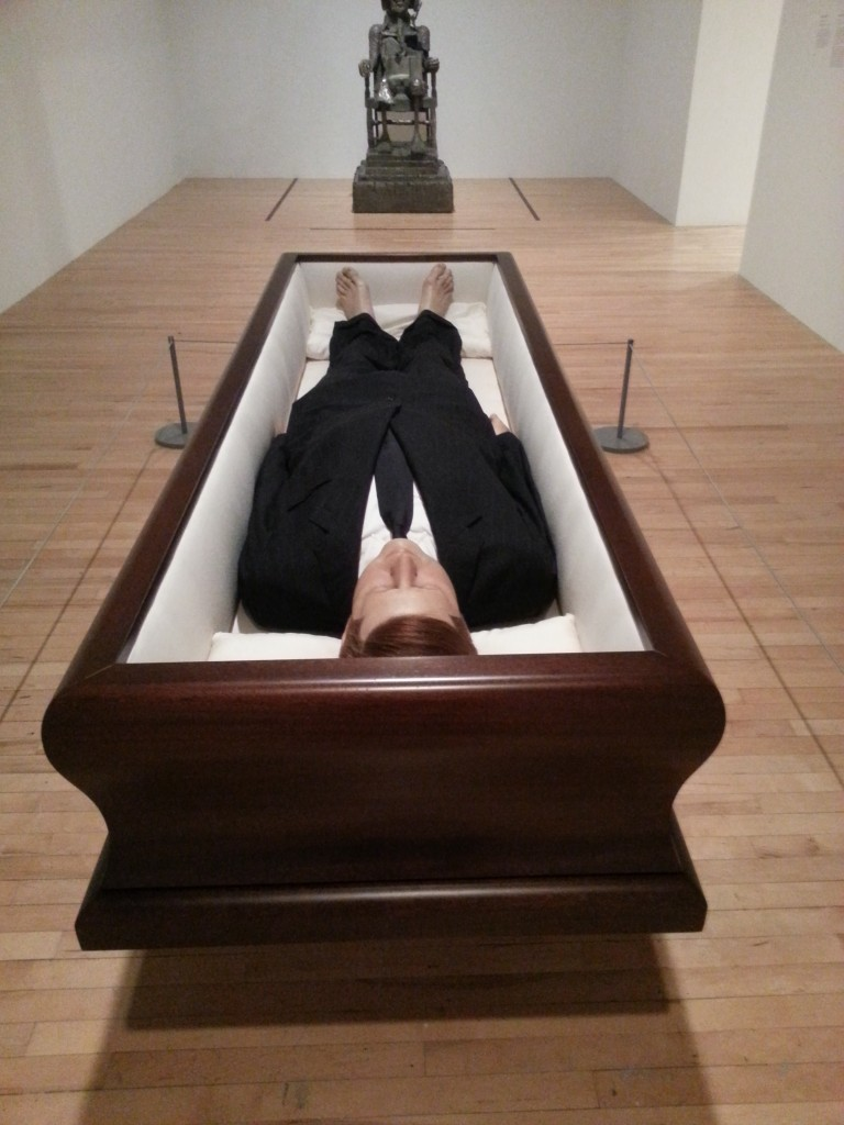 Maurizio Cattelan Now 2004.  Polyester resin wax pigment human hair clothing and coffin.